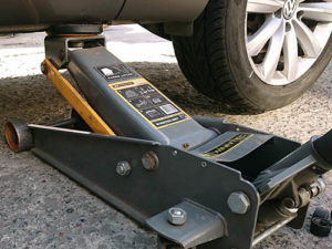 floor jack under the car
