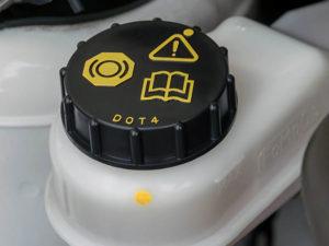 check the level of brake fluid
