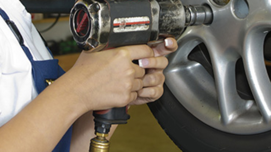 Power impact wrench in use