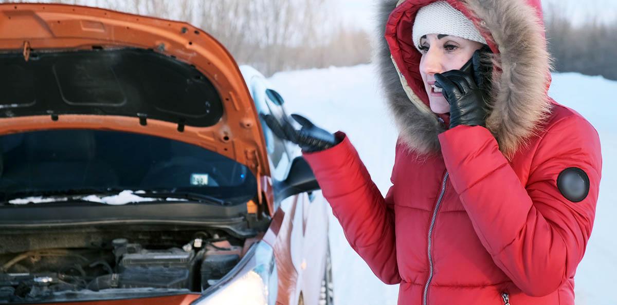 Girl in roadside emergency at winter
